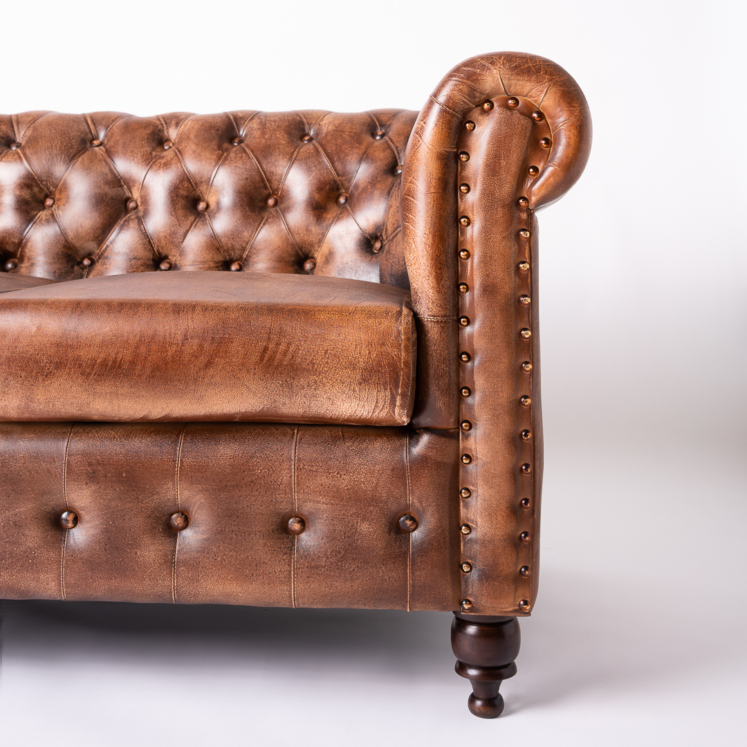 Canapea piele maro detaliu brat stang